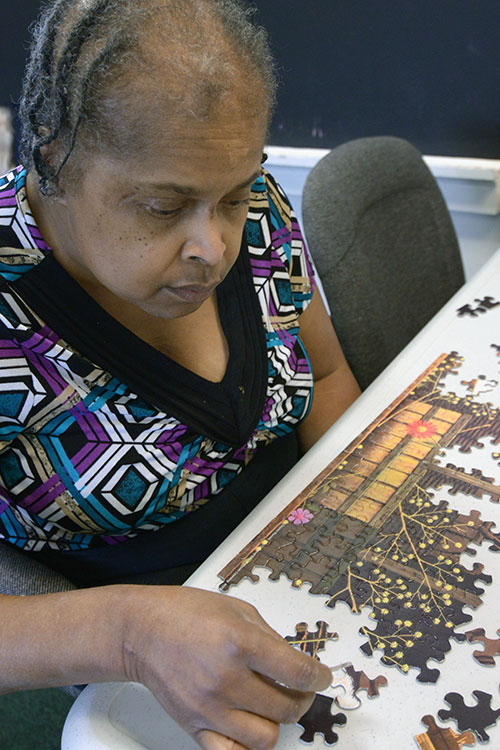 resident working on a puzzle